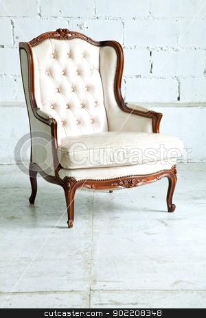 sofa in vintage room stock photo, White genuine leather classical style sofa in vintage room by Vichaya Kiatying-Angsulee