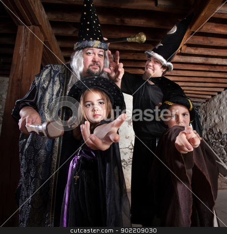 Halloween Wizard Family stock photo, Cute family of people dressed in Halloween costumes by Scott Griessel