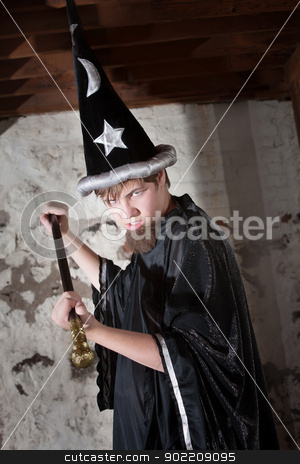 Insulted Young Wizard with Scepter stock photo, Menacing teenager dressed as wizard with tall hat and scepter by Scott Griessel