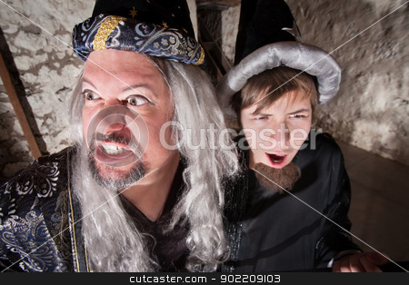 Evil Wizard with Son stock photo, Evil long haired wizard with teenage son by Scott Griessel