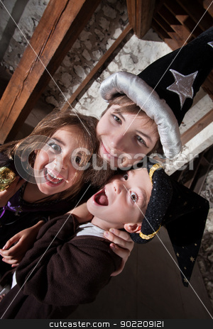 Loving Wizard Siblings stock photo, Young sibling wizards laughing and hugging each other by Scott Griessel