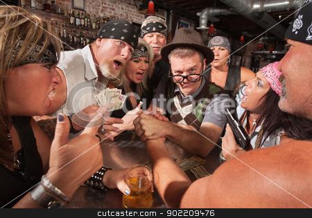 Nerd Arm Wrestling with Gambling Bikers stock photo, Biker gang gambling in nerd arm wrestling match  by Scott Griessel