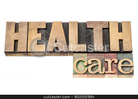 health care in wood type stock photo, health care  - isolated text in vintage letterpress wood type printing blocks by Marek Uliasz