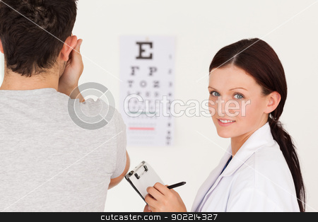 Optician and a patient stock photo,  by Wavebreak Media