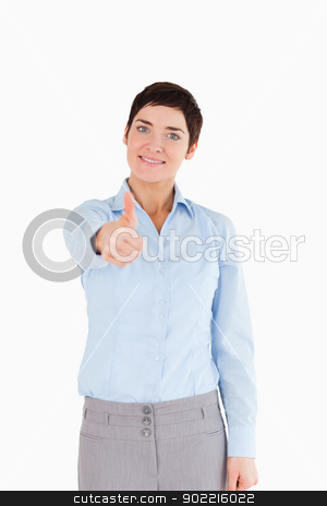 Portrait of a businesswoman with her thumb up stock photo, Portrait of a businesswoman with her thumb up against a white background by Wavebreak Media