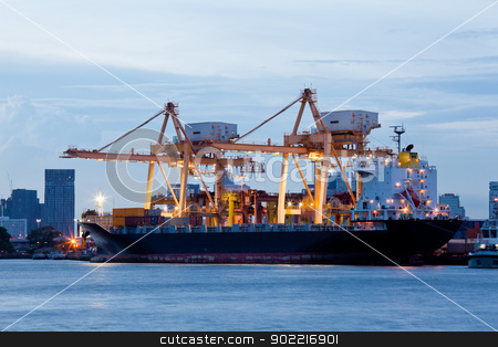 Logistic Import Export Freight stock photo, Container Cargo freight ship with working crane bridge in shipyard at evening for Logistic Import Export background by Vichaya Kiatying-Angsulee