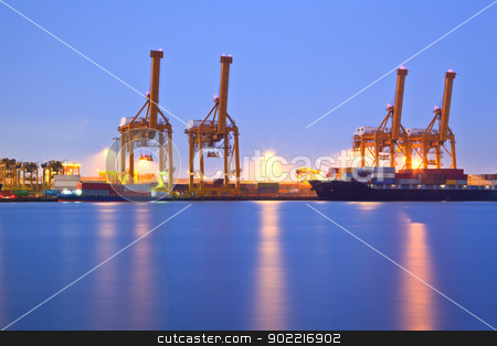 Shipping Terminal port stock photo, Container stacks and crane in shipyard at dusk for cargo Goods and Logistic background by Vichaya Kiatying-Angsulee