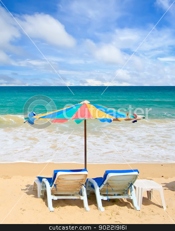 Beach Chair stock photo, Couple chair and multi-color umbrella on the beach with perfectly sky by Vichaya Kiatying-Angsulee