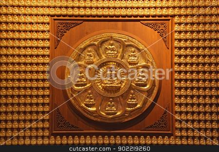 golden wheel of buddha on wall in dragon temple Thailand stock photo, golden wheel of buddha on wall in dragon temple Thailand by Vichaya Kiatying-Angsulee
