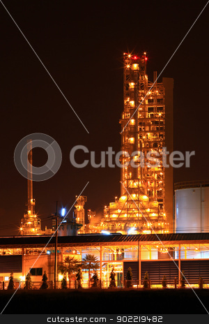 petrochemical oil refinery plant stock photo, scenic of petrochemical oil refinery plant shines at night, vertical closeup by Vichaya Kiatying-Angsulee