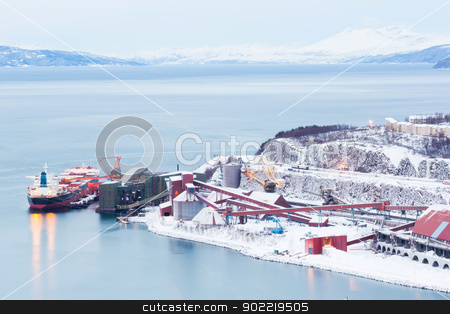 Iron Ore Mine Factory stock photo, Industrial Container Cargo freight ship with working crane bridge in shipyard at Iron Ore Mine Factory Plant in Narvik Norway by Vichaya Kiatying-Angsulee