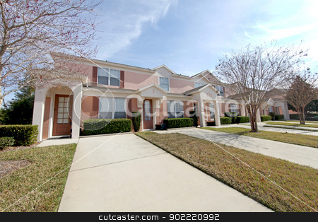 Townhomes stock photo, A set of pink townhomes in Florida by Lucy Clark
