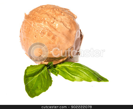Scoop of chocolate ice cream with mint leaf stock photo, Scoop of chocolate ice cream with mint leaf by Andrey Starostin