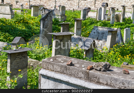The Remuh Cemetery in Krakow, Poland, is a Jewish cemetery estab stock photo, The Remuh Cemetery in Krakow, Poland, is a Jewish cemetery established in 1535. It is located beside the Remuh Synagogue by Andrey Starostin