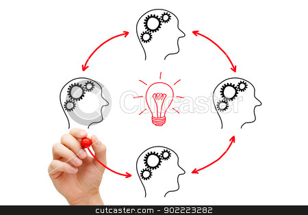 Teamwork Builds Big Idea stock photo, Teamworking on an idea. If everybody gives a little, it adds up. by Ivelin Radkov