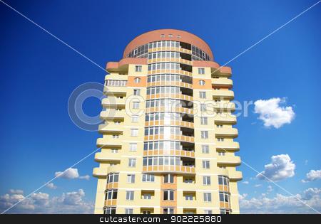 apartments stock photo, A modern apartments building on sky by Vitaliy Pakhnyushchyy