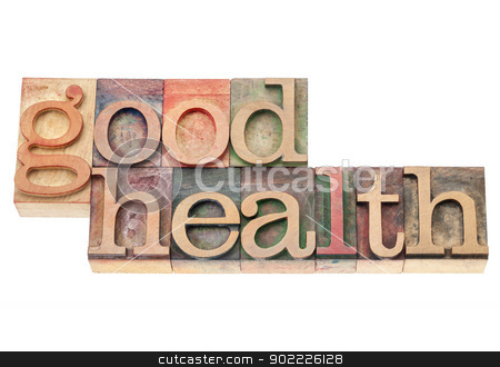 good health in wood type stock photo, good health  - wellness concept - isolated text in vintage letterpress wood type printing blocks by Marek Uliasz