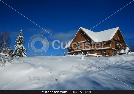 House in winter stock photo, Big wood house in winter cover with snow by Claude Gariepy