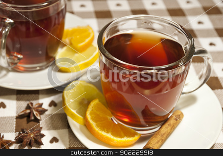 Tea cups at the table stock photo, Tea cups at the table with slice of orange and lemon by dinozzaver