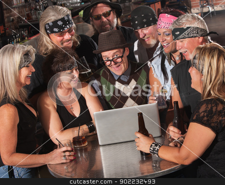 Nerd on Computer with Bikers stock photo, Confident nerd on computer with adoring motorcycle bike gang  by Scott Griessel