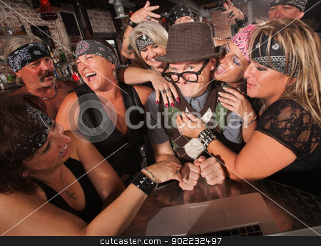 Happy Nerd with Biker Gang Ladies stock photo, Excited male nerd with adoring female biker gang by Scott Griessel
