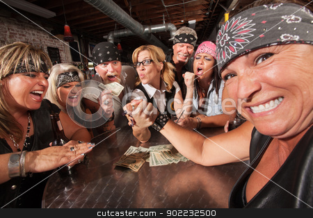 Nerd Beats Biker in Arm Wrestling stock photo, Tough female losing an arm wrestling contest with nerd by Scott Griessel