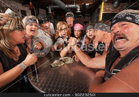 Painful Arm Wrestling Match with Nerd stock photo, Tough middle aged man in pain while arm wrestling with nerd by Scott Griessel
