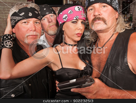 Biker Gang with Beautiful Woman stock photo, Three motorcycle gang members with beautiful woman in leather by Scott Griessel