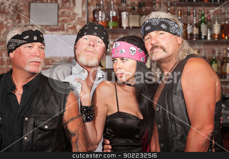 Lady with Three Tough Men stock photo, Sexy lady with 3 tough motorcycle gang members in bar by Scott Griessel