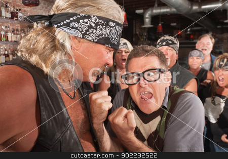 Nerd With Fists Against Strong Man stock photo, Angry nerd with clenched fists facing strong gang member by Scott Griessel