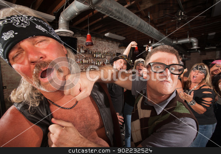 Geek Punches Man in Bar stock photo, Confident geek punches mature biker gang man on chin by Scott Griessel