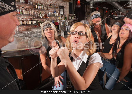 Female Nerd Confronting Man in Bar stock photo, Female geek puts up fist to tough man in bar by Scott Griessel