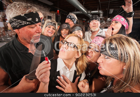 Gang Making Fun of Nerd with Knife stock photo, Biker gang making fun and threatening nerd with weapons by Scott Griessel