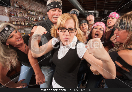 Brave Female Nerd with Biker Gang stock photo, Brave nerd lady with fists up among laughing biker gang by Scott Griessel