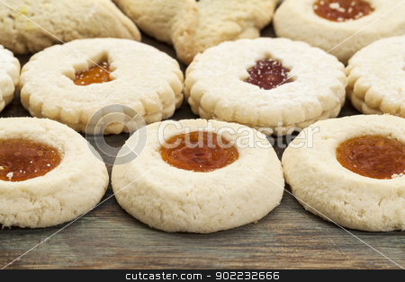 jelly biscuit cookies stock photo, rows of fruit jelly biscuit cookies on painted wood background by Marek Uliasz