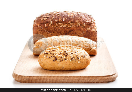 Different types of bread  stock photo, Different types of bread on wooden plate by Grafvision