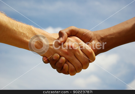 hands stock photo, Two young businessmen shaking hands by Vitaliy Pakhnyushchyy