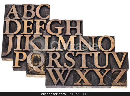alphabet abstract in wood type stock photo, uppercase English alphabet in vintage letterpress wood type printing blocks, isolated on white by Marek Uliasz