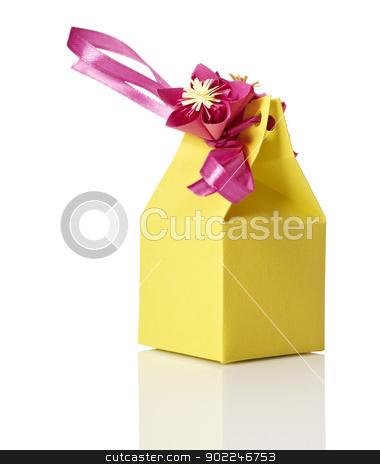 Gift box stock photo, Studio shot of small gift box with decoration. Box isolated on white background. by Filip Warulik
