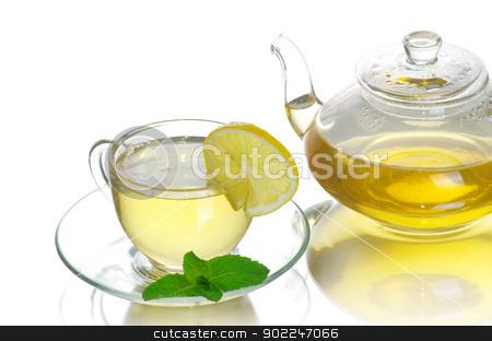 tea cup stock photo, Tea being poured into glass tea cup by Vitaliy Pakhnyushchyy