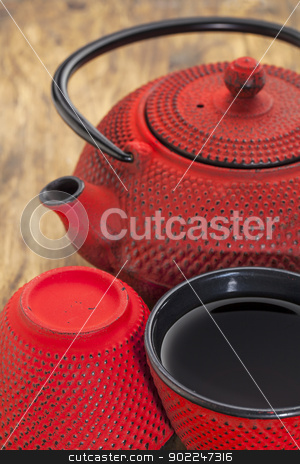 red tetsubin with cups stock photo, red hobnail tetsubin with a cup of tea - a detail of a traditional cast iron Japanese teapot set by Marek Uliasz