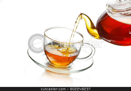 tea  stock photo, Tea being poured into glass tea cup by Vitaliy Pakhnyushchyy