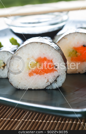 Japanese Sushi stock photo, Selection of japanese sushi arranged on black plate by Tiramisu Studio