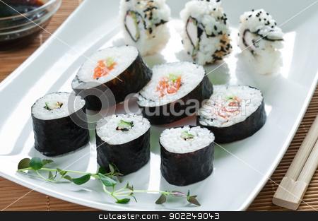 Japanese Sushi stock photo, Selection of japanese sushi arranged with thyme on white plate by Tiramisu Studio