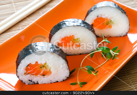 Japanese Sushi stock photo, Selection of Japanese sushi arranged with thyme on red plate by Tiramisu Studio