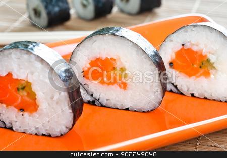 Japanese Sushi stock photo, Selection of Japanese sushi arranged on red plate by Tiramisu Studio