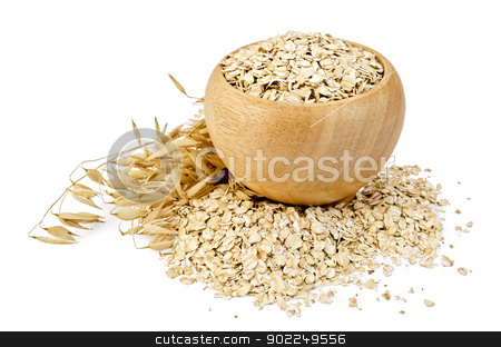 Oat flakes in a bowl stock photo, Oat flakes in a wooden bowl, stalks of oats, oat flakes scattered on the table isolated on white background by rezkrr