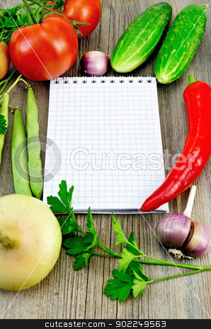 Notebook with vegetables and pepper stock photo, Small notepad, red tomatoes, pod red pepper, parsley, garlic, onion, two cucumbers, green bean pods on an old wooden board by rezkrr