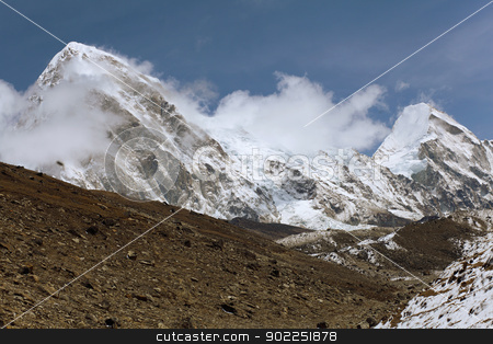 snowy mountains stock photo, High mountains in cloud. Nepal. Near Everest by Sergey Nivens