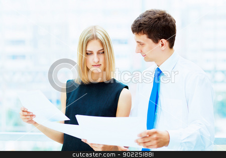 Two young business collegues. stock photo, Two young business collegue working together in office by Sergey Nivens